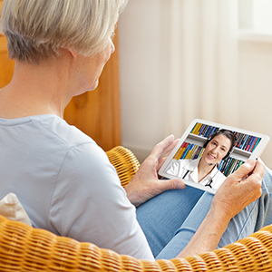 Crossroads' patient talking to a doctor via TeleHealth.